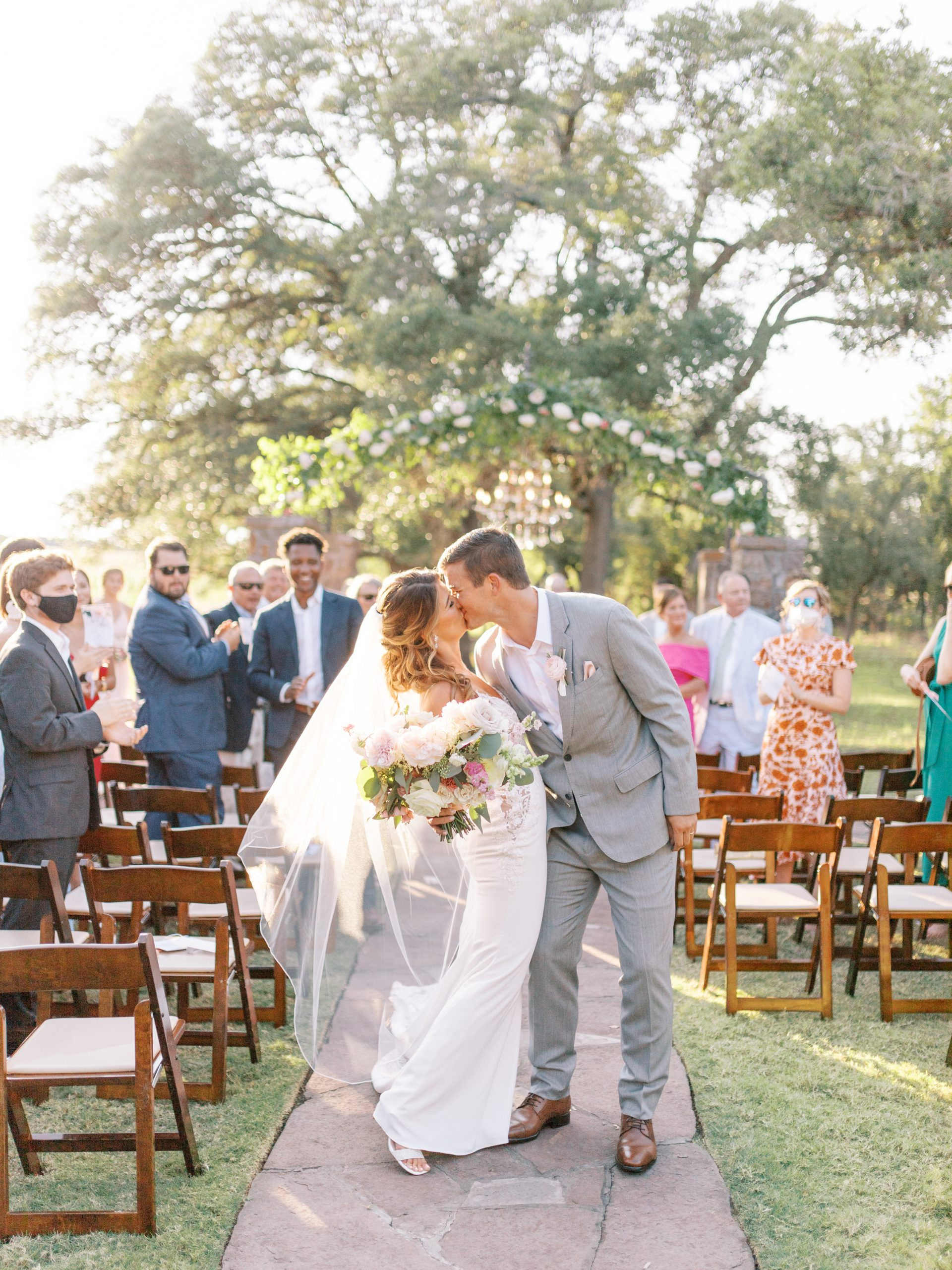 couple walking down the aisle at ma maison wedding venue dripping springs texas