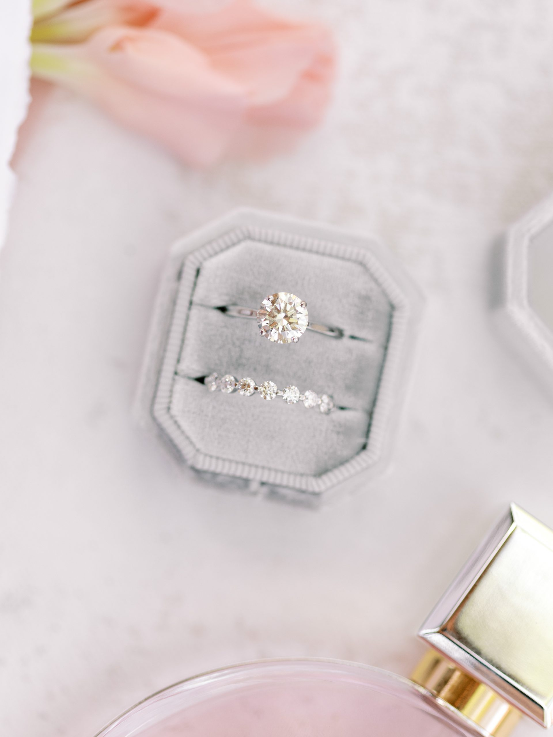 Engagement ring and wedding band in a gray Mrs. Box
